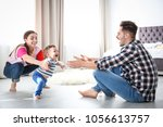 happy family playing and baby... | Shutterstock . vector #1056613757