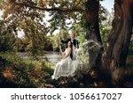 wedding couple. beautiful bride ...   Shutterstock . vector #1056617027