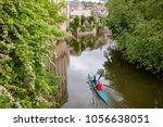 two women kayaking down the... | Shutterstock . vector #1056638051