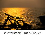 silhouette of bicycle on the... | Shutterstock . vector #1056642797