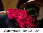 a bouquet of red roses lies on... | Shutterstock . vector #1056653654