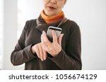 a positive modern elderly woman ... | Shutterstock . vector #1056674129