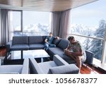 handsome casual young men using ... | Shutterstock . vector #1056678377