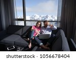 young couple relaxing at  home... | Shutterstock . vector #1056678404