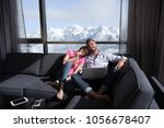 young couple relaxing at  home... | Shutterstock . vector #1056678407