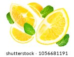 flying oranges with mint leaves ... | Shutterstock . vector #1056681191