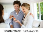 happy young couple getting keys ... | Shutterstock . vector #105669041