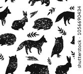 Stock vector animal artistic silhouettes seamless pattern 1056690434