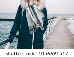 young woman stands on the... | Shutterstock . vector #1056691517