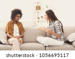 two female friends sitting on... | Shutterstock . vector #1056695117