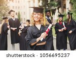 young woman on her graduation... | Shutterstock . vector #1056695237