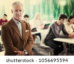 portrait of confident teacher... | Shutterstock . vector #1056695594
