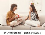 excited woman getting gift from ... | Shutterstock . vector #1056696017