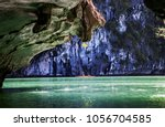 kayaking among caves and lagoon ... | Shutterstock . vector #1056704585