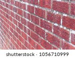red brick wall close up side... | Shutterstock . vector #1056710999