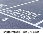 close up reserved parking space ... | Shutterstock . vector #1056711335