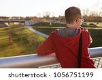 man looking out over scioto... | Shutterstock . vector #1056751199