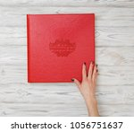 a person is viewing a photo... | Shutterstock . vector #1056751637