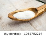 Small photo of Artificial Sweeteners and Sugar Substitutes in wooden spoon. Natural and synthetic sugarfree food additive: sorbitol, fructose, honey, Sucralose, Aspartame
