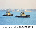 tugboat in harbor quayside of...   Shutterstock . vector #1056775994