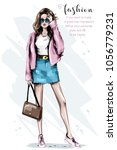 fashion look. beautiful young... | Shutterstock .eps vector #1056779231