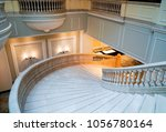 curvilinear stairs. upside view ... | Shutterstock . vector #1056780164