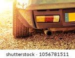 exhaust and rear light of a... | Shutterstock . vector #1056781511