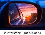 fiery sunset as seen on the car'... | Shutterstock . vector #1056800561