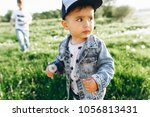 two brothers in the nature | Shutterstock . vector #1056813431