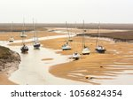 Small Boats At Low Tide At...
