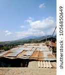 Small photo of A view above the roofs above a row of homes in the most impoverished community in Cali, Colombia.