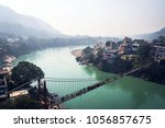 ram jhula is an iron suspension ... | Shutterstock . vector #1056857675