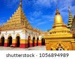 mahamuni pagoda on a blue sky... | Shutterstock . vector #1056894989