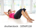 young asian woman doing sit ups ... | Shutterstock . vector #10569118