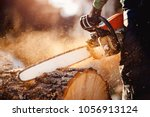 chainsaw in move cutting wood.... | Shutterstock . vector #1056913124