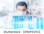 scientist make chemical... | Shutterstock . vector #1056931511