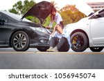 both cars are in accident clash ... | Shutterstock . vector #1056945074