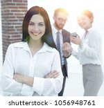 Small photo of successful young business woman against the background of collea