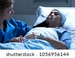 sick  older woman with pale ... | Shutterstock . vector #1056956144