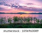 amazing sunset at loch creran ... | Shutterstock . vector #1056963089