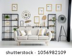 beige sofa with gold cushions... | Shutterstock . vector #1056982109