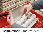 hands woman with packages of...   Shutterstock . vector #1056990974