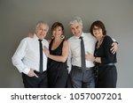 cheerful fancy senior couples... | Shutterstock . vector #1057007201