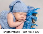 baby dressed in knitted yellow... | Shutterstock . vector #1057016129