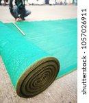 roll of green plastic sunshade... | Shutterstock . vector #1057026911
