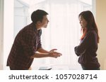 Small photo of Negative emotions of couples concept. Asian People Thai in the fight. Husband and wife arguing and yelling expressive and emotional couple having an argument or the quarrel at home