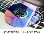 dvd disc isolated on computer... | Shutterstock . vector #1057045931