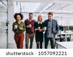 group of diverse coworkers... | Shutterstock . vector #1057092221