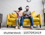 father and daughter in vr... | Shutterstock . vector #1057092419