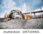 industrial machinery on highway ...   Shutterstock . vector #1057104401